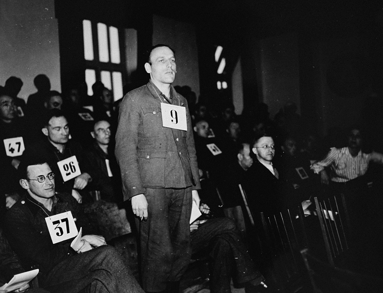 Former SS-Unterscharfuehrer Hans Diehl, a defendant at the trial of 61 former camp personnel and prisoners from Mauthausen, stands in his place in the defendants' dock.    Diehl was convicted and sentenced to death on May 13, 1946.