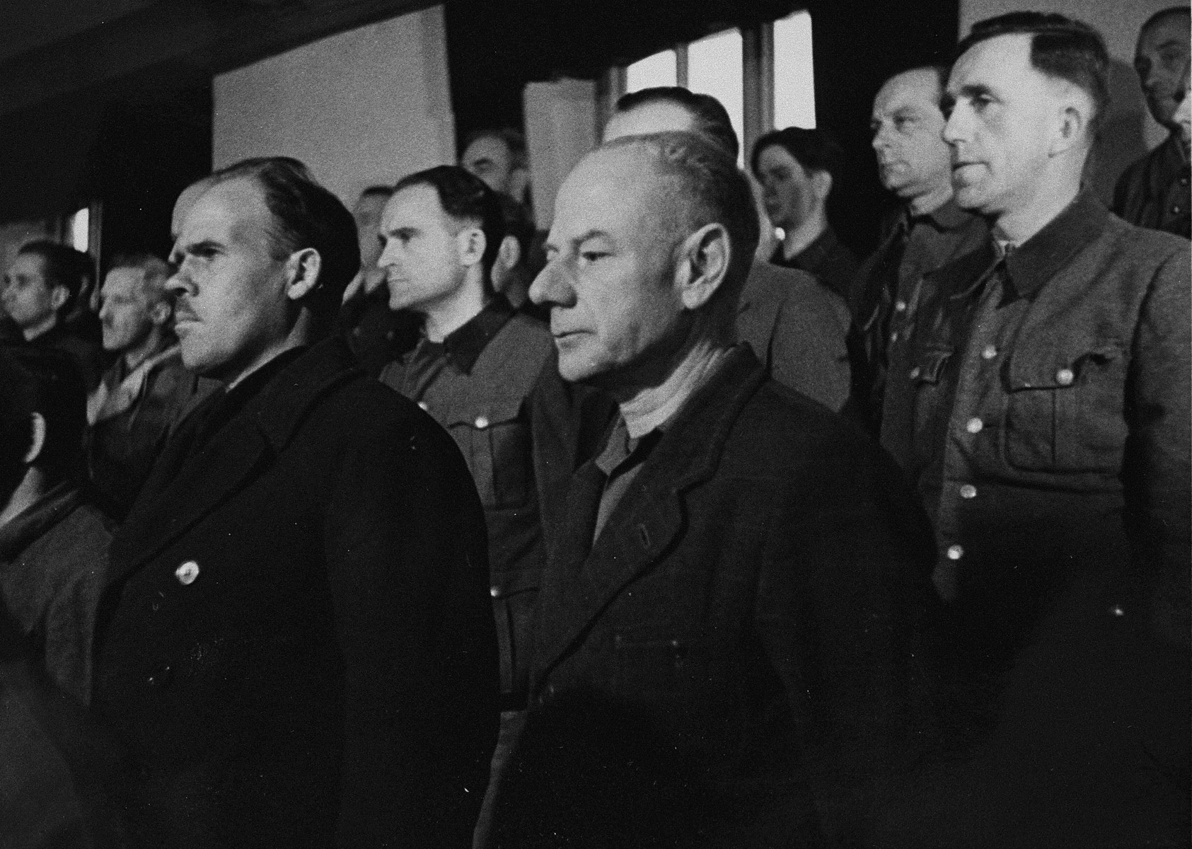 View of the defendants' dock during a session of the trial of 61 former camp personnel and prisoners from Mauthausen.    Pictured in front is defendant Dr. Eduard Krebsbach.