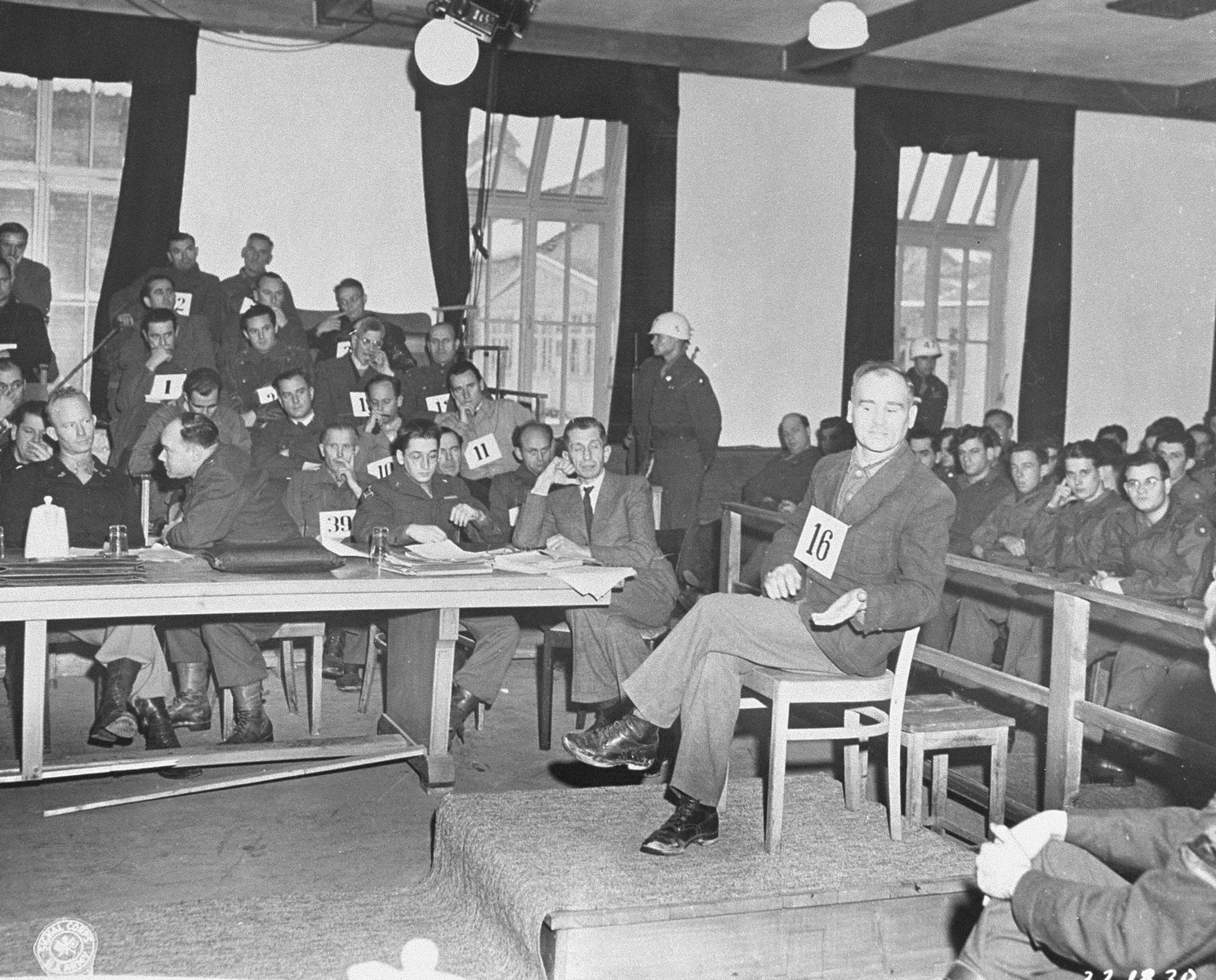 Defendant Christof Ludwig Knoll, a former political prisoner and block leader, testifies at the trial of former camp personnel and prisoners from Dachau.