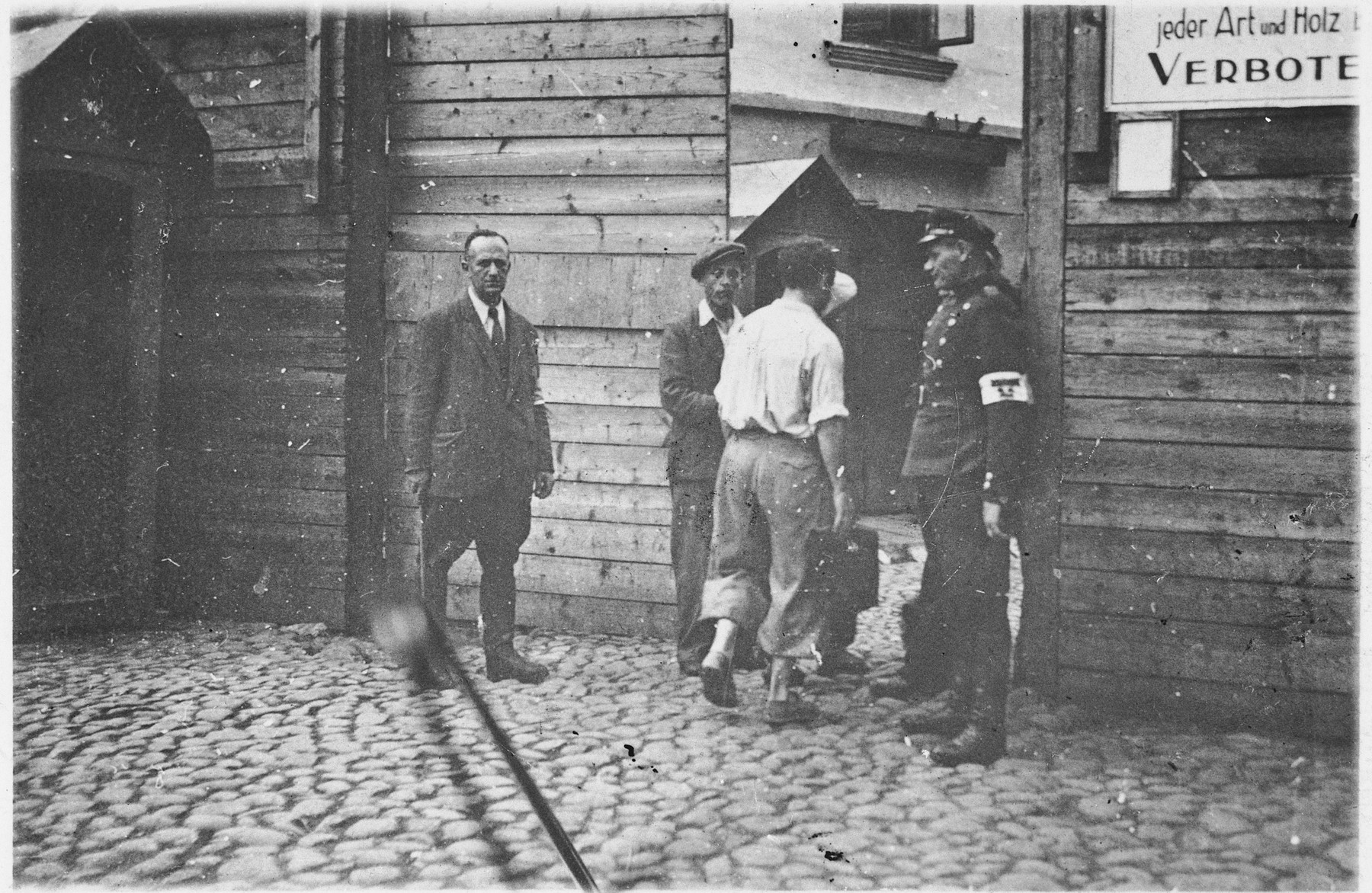 Jewish and Lithuanian police guard the entrance to the Vilna ghetto.  Pictured at the left is Ferdinand Beigel.