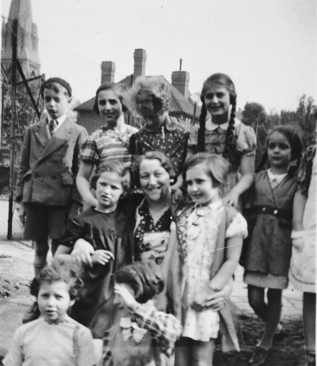 Group portrait of girls in from the 5th Avenue Hostel who came to England on a Kindertransport.  Henni Zajac is pictured standing on the left in the second row.  Pictured on the top row left is possibly Fred Gottlieb and on the top row right is possibly his sister, Miriam Gottlieb.
