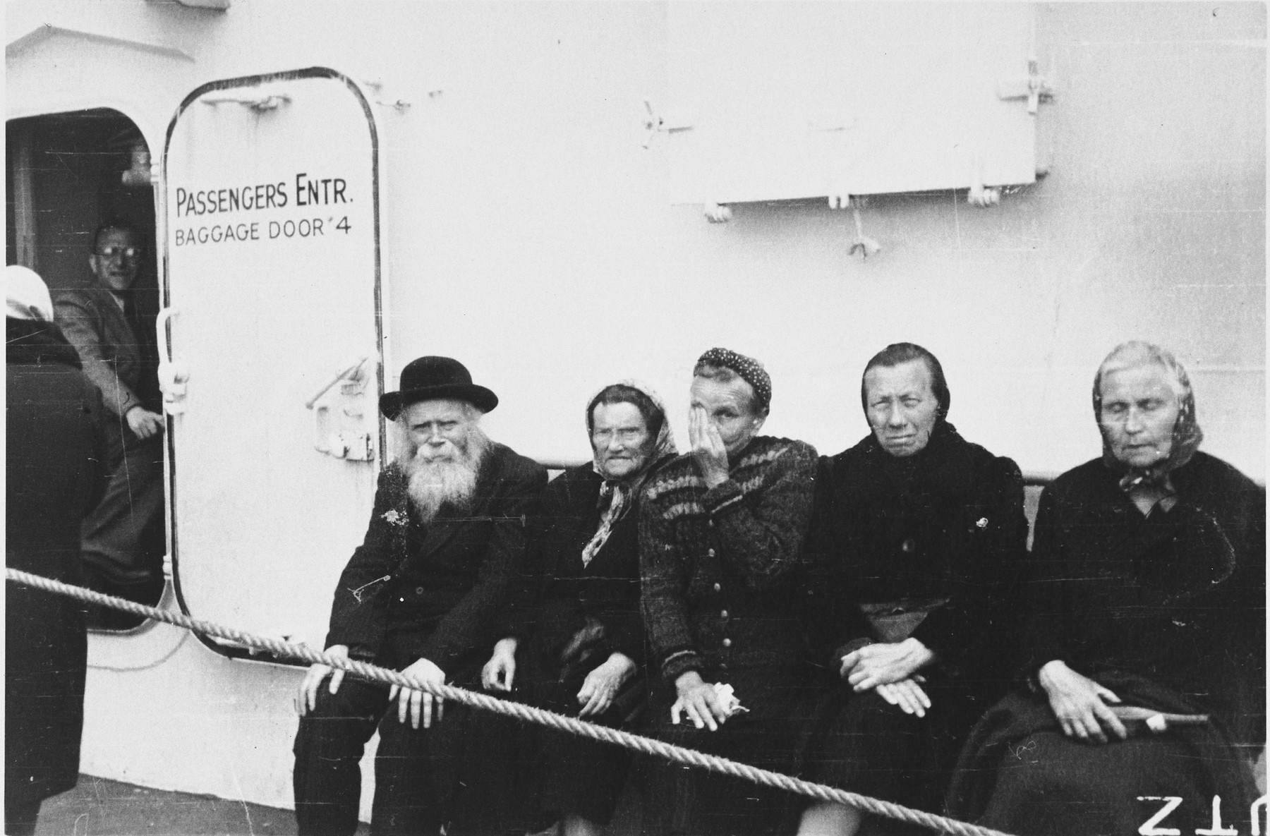 Elderly Jews sit on the deck of the SS Marine Marlin while en route to the United States.  Among those pictured (seated on the far left) are Shlomo Chaim and Brandel (nee Hoffert) Nussbaum, from Kolbuszowa, Poland. They survived the war as prisoners in a gulag in Siberia, with their daughter.