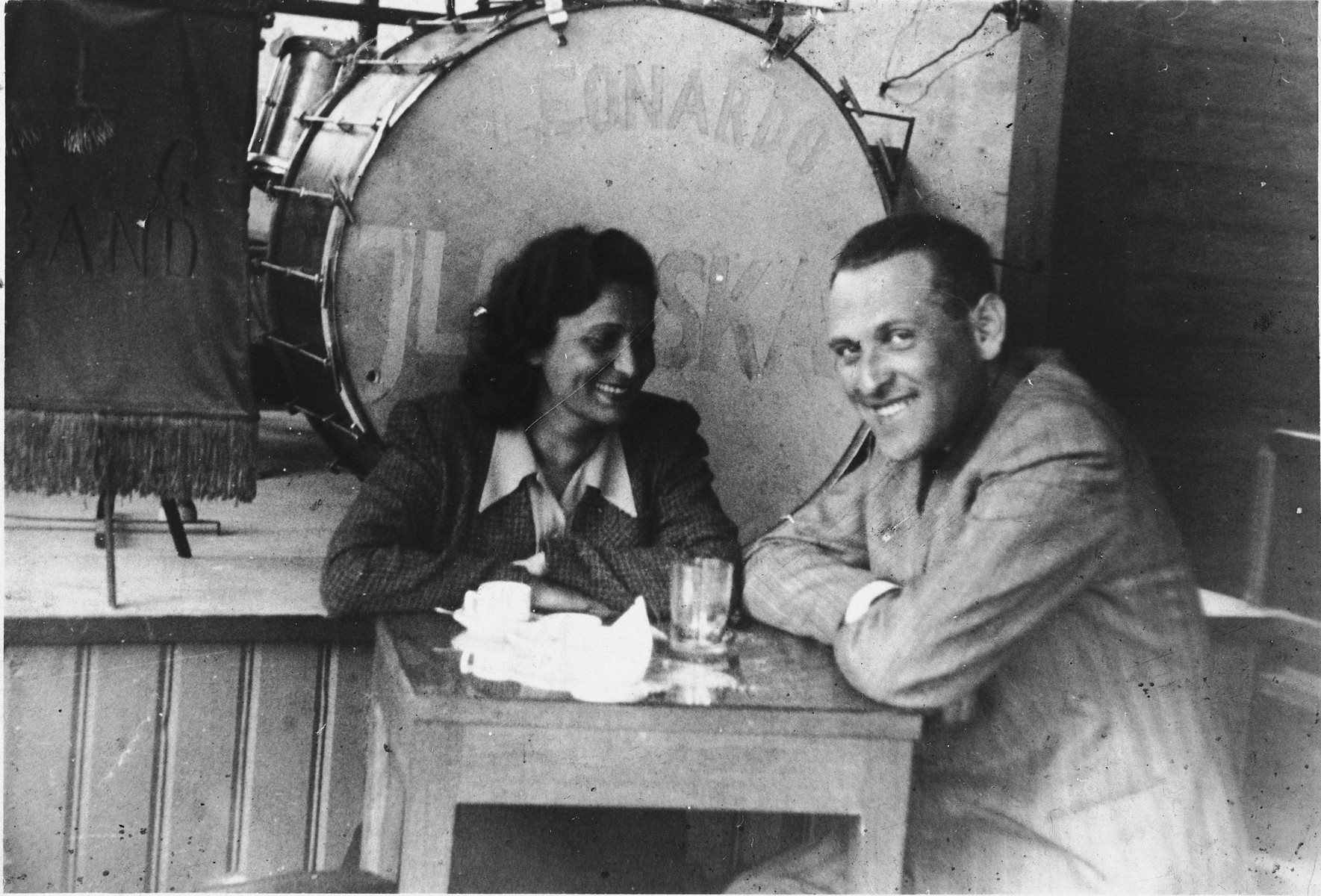 Two Jewish friends sit in a coffee house in Vilna during the Soviet occupation.  Pictured are Liza Beigel and Moshe Seligson.