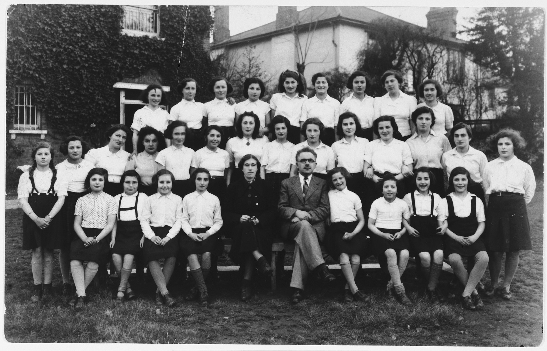 Group portrait of girls in from the 5th Avenue Hostel who came to England on a Kindertransport.  Anni Zajac is pictured standing on the right.