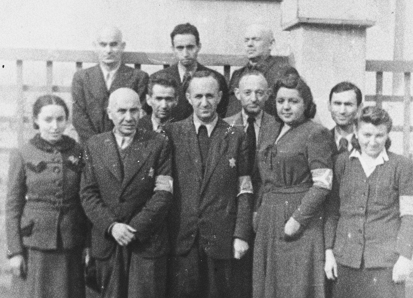 Group portrait of members of the Vilna ghetto Jewish police.  Among those pictured is Ferdinand Beigel (front row center).