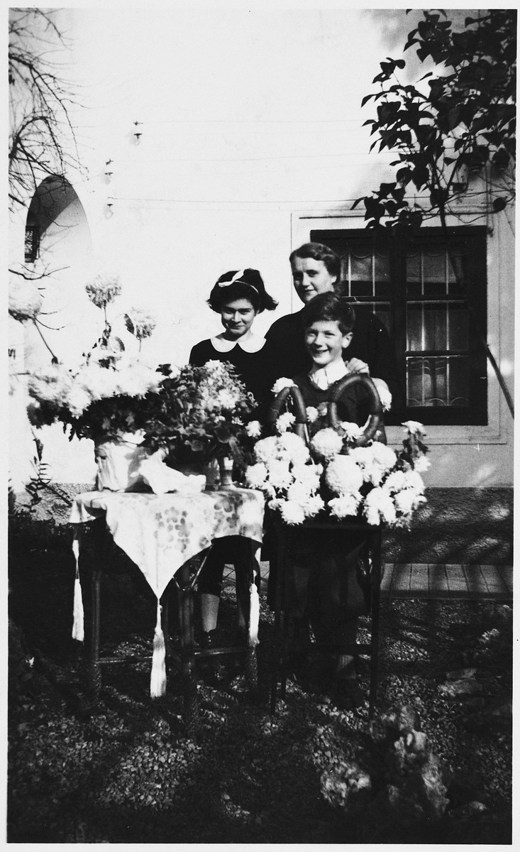 Gerhard Mahler celebrates his tenth birthday with his sister and nanny.  From left to right are Sylvia Mahler, Ilse Huebner and Gerhard Mahler.  The number 10 centerpiece is fashioned out of sausage.