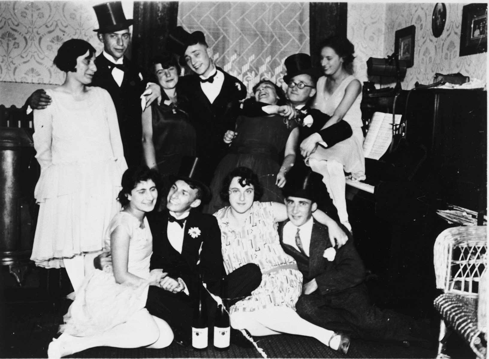German-Jewish young adults celebrate New Years eve together.  Harri Hoffman is standing fourth from the left.  Herta Goldschmidt is at the far right.