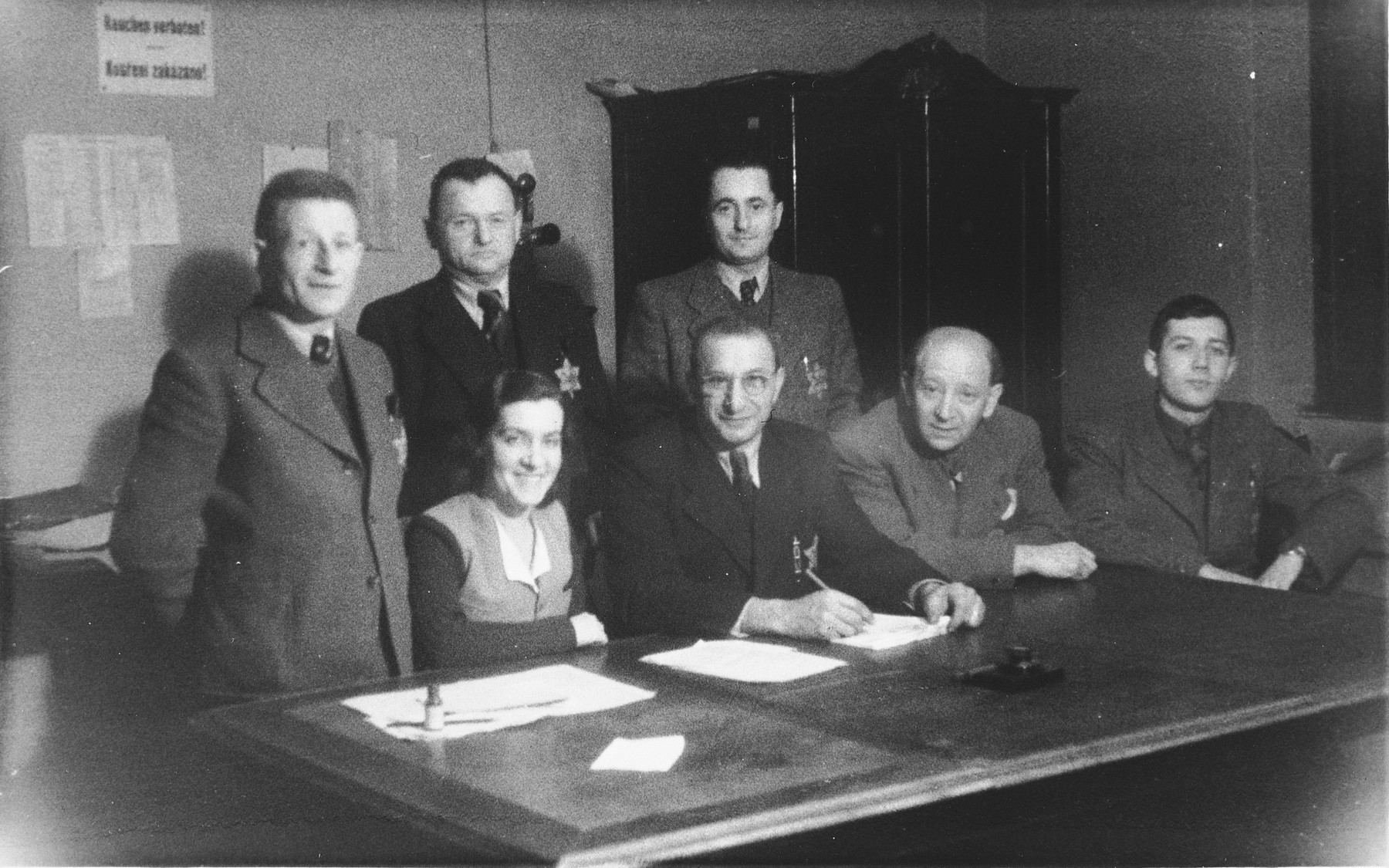 Workers in a Jewish administrative office, probably in Uhersky Brod.  Standing on the left is Mauric Ganger.  He and his wife Emilie were deported from Uhersky Brod to Theresienstadt on January 23, 1943 and from there to Auschwitz where they perished.