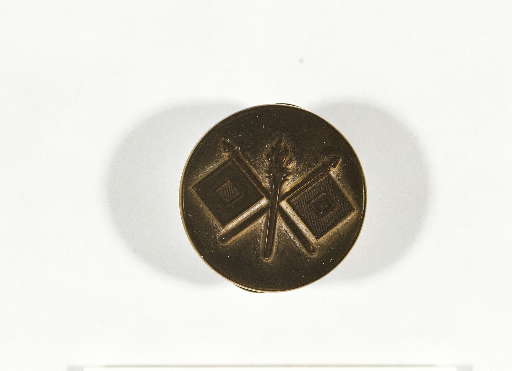 U.S. Army Signal Corps pin issued to combat photographer Arnold E. Samuelson.