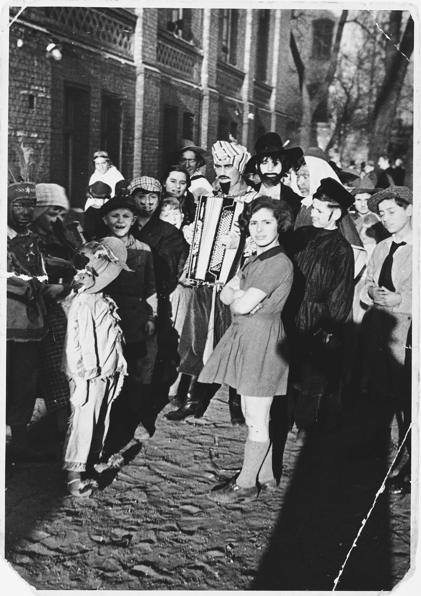 Children from the AHAWAH orphanage attend a Purim carnival.  In the front right is Anni Zajac.  She is not in costume because she is in mourning following her mother's death.