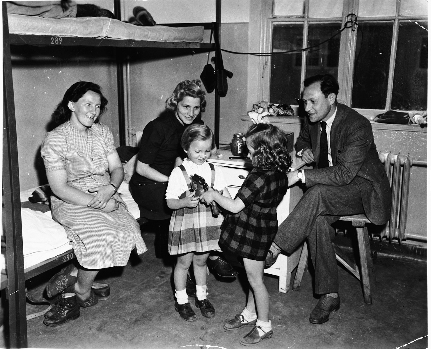 The Starkopf family visits with friends in the Feldafing displaced persons camp.