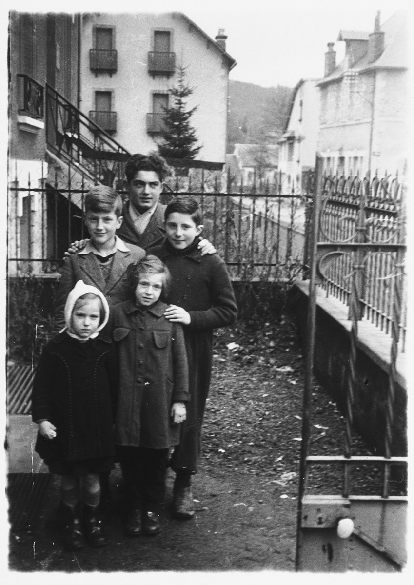 Gerhard Mahler poses with the children of a family in La Bourboule who hosted his bar mitzvah.  Gerhard Mahler is pictured in the middle, left.