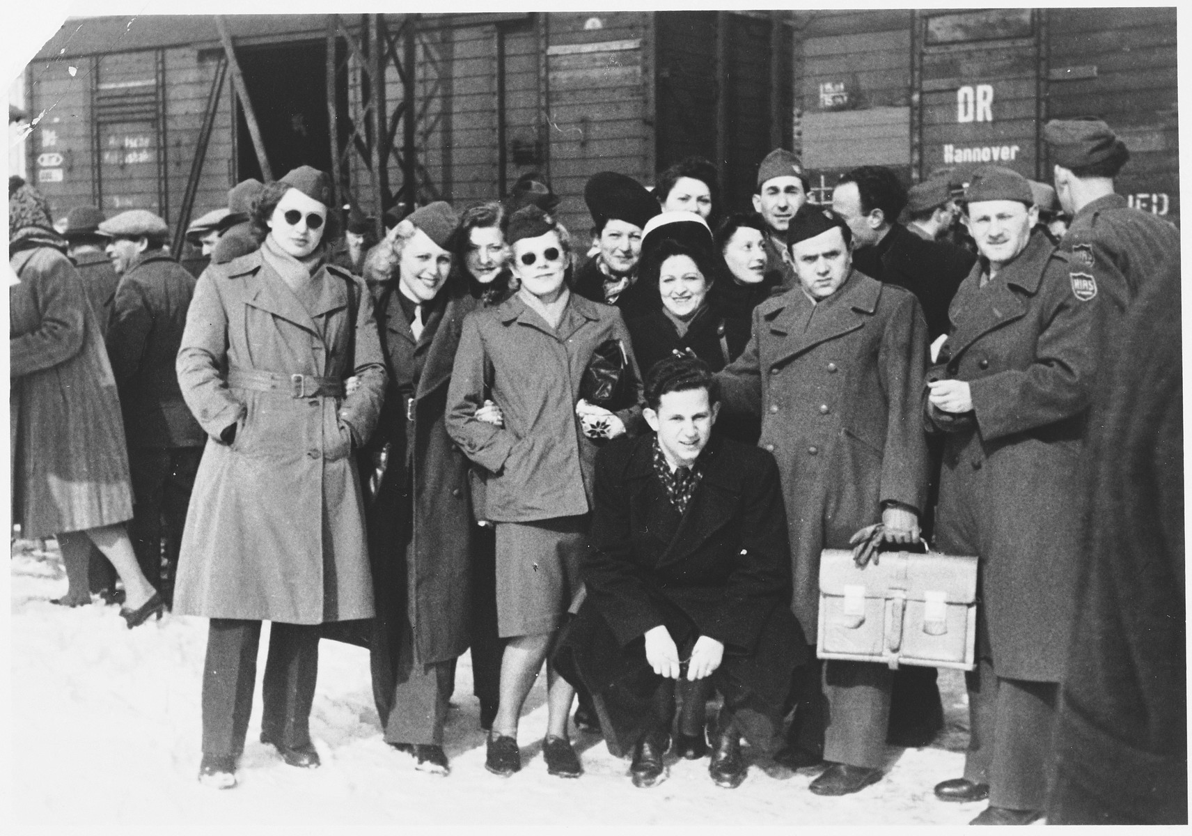 Wilhelm Beigel (kneeling in front) poses with HIAS workers at the Munich train station prior to his departure for the U.S.