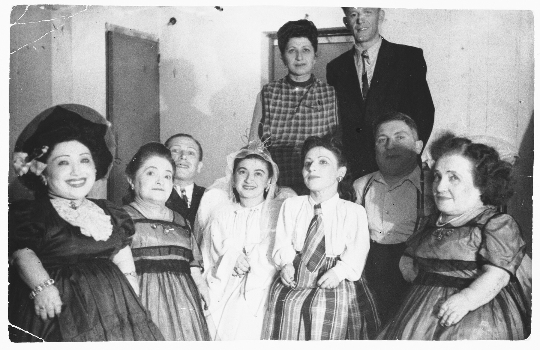 Group portrait of the Ovici family, a family of Jewish dwarf entertainers who survived Auschwitz.  The two people of normal height standing in the back are their sister Sara Ovici, and Moshe Moskowitz, the husband of Elisabeth Ovici.