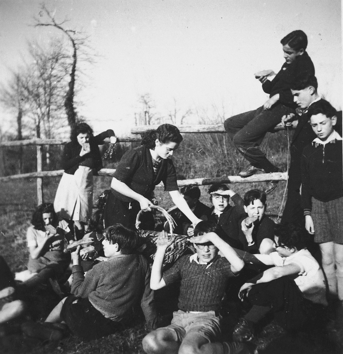 Jewish refugee teenagers enjoy a snack on the grounds of the Chateau de Chabannes OSE [Oeuvre de Secours aux Enfants] children's home.