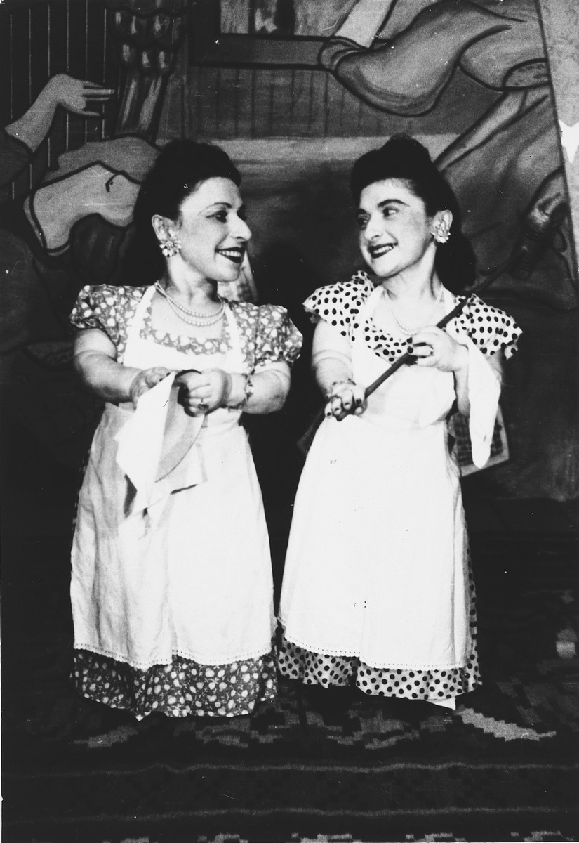 Two members of the Ovici family, a family of Jewish dwarf entertainers who survived Auschwitz, perform on stage.  Pictured are Perla and Elizabeth Ovici.