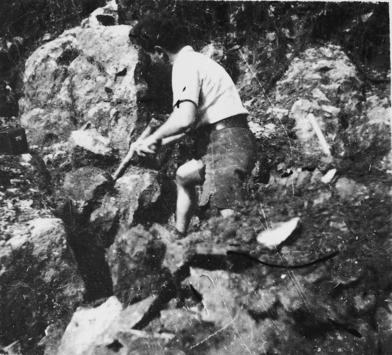 Jewish refugee Eryk Golfarb works at widening a mountain road while living in hiding in Col de Menee, France.