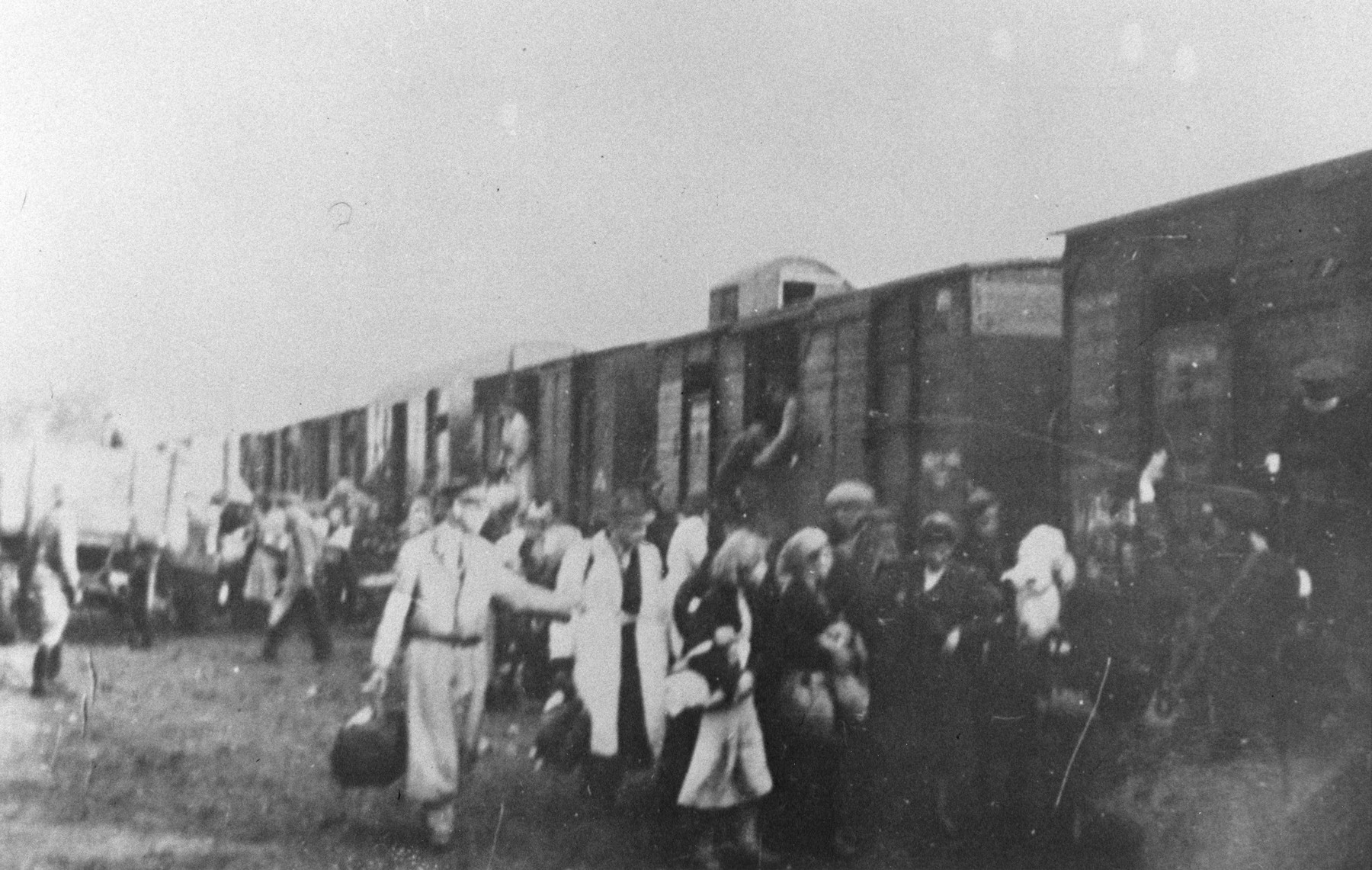 Jews from the Warsaw ghetto board a deportation train with the assistance of Jewish police.