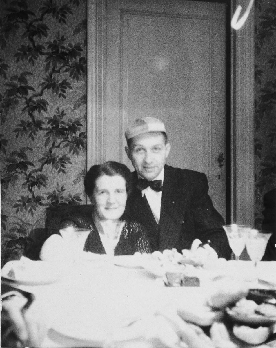 Klara and Siegfried Chraplewski celebrate New Years in their apartment in Brussels.