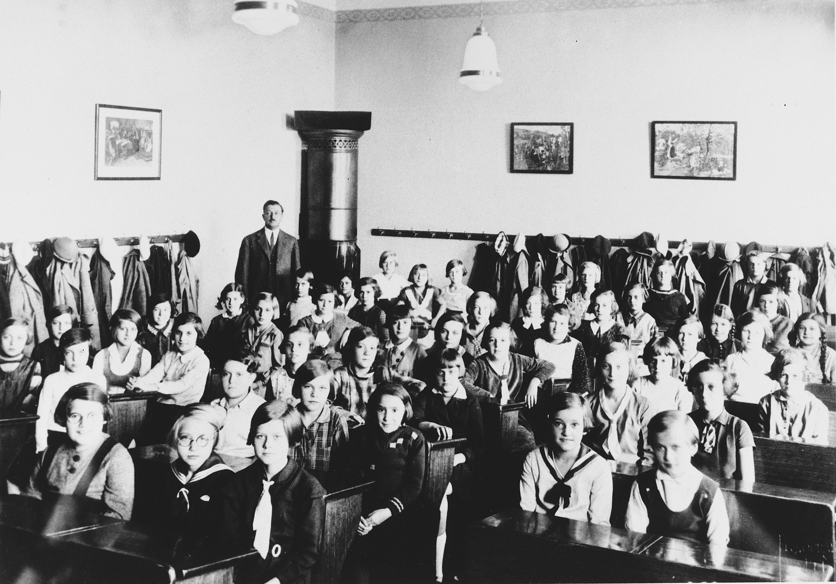 Children sit in a classroom at a grammar school in Prague.  Some of the girls are Jewish.  Among those pictured is Hana Fuchs.