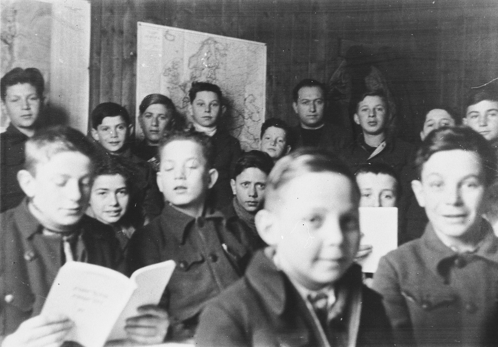 Children read from their texts in a school in the Stuttgart DP camp.  Those pictured include Miron Bander and Tom Ferbel.