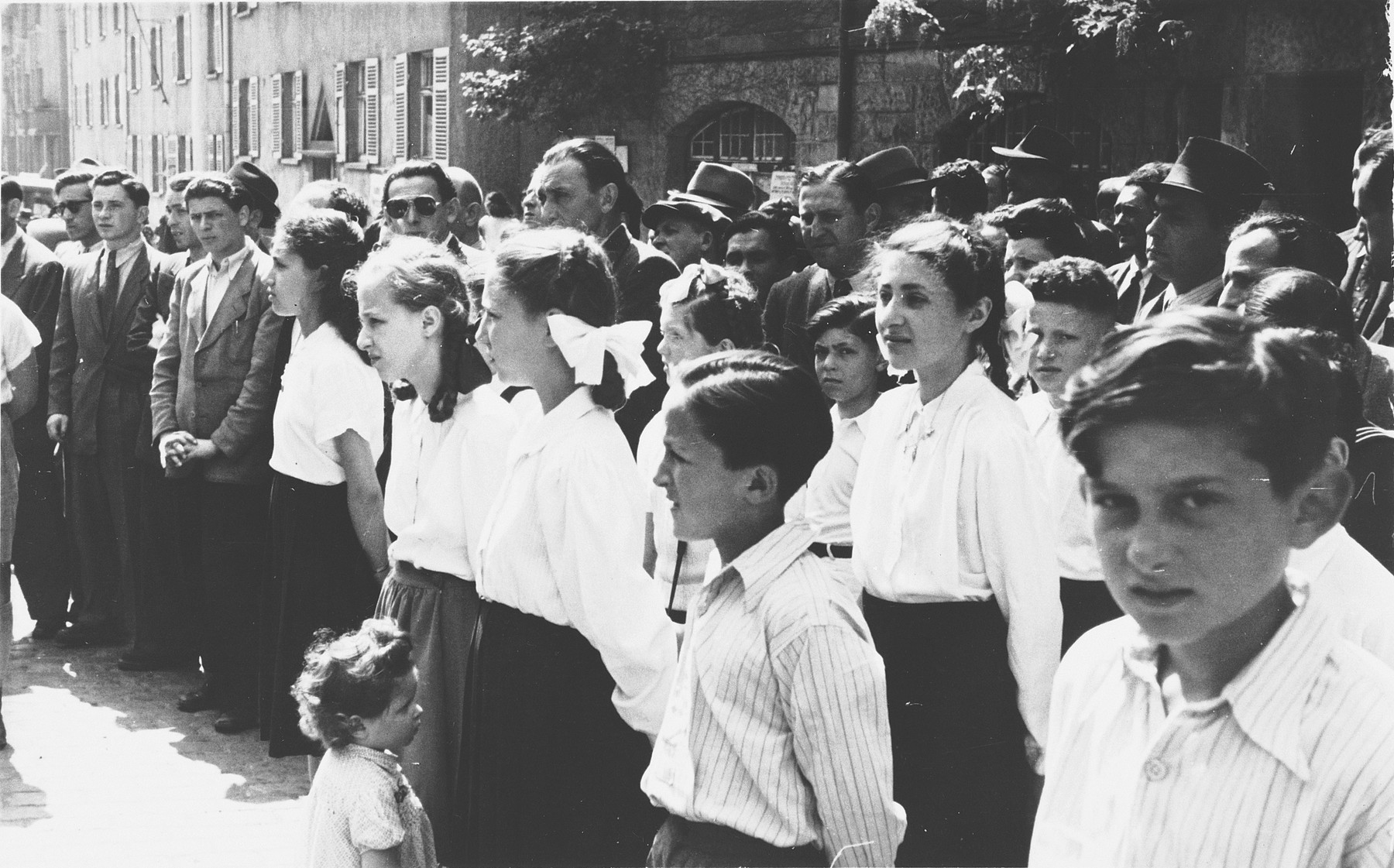 School children gather for a ceremony marking Israel's independence in the Stuttgart displaced persons' camp.