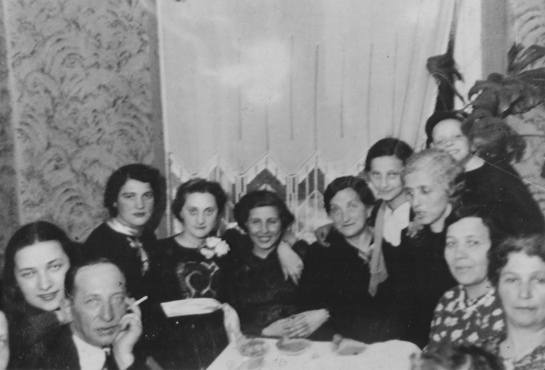 Members of the Fefer and Sztajman families at a gathering in the Fefer home in Lublin to celebrate the engagement (Tenayim) of Majer Sztajman and Sylka Fefer.  Pictured (left to right:) are the donor's uncle, Blima Fefer, Rachela Fefer, Fela Sztajman, bride Sylka Fefer, Mother of groom Sura Sztajman, Ruth Sztajman, mother of bride Chawa Fefer, Jerachmyel, and two of the donor's aunts.