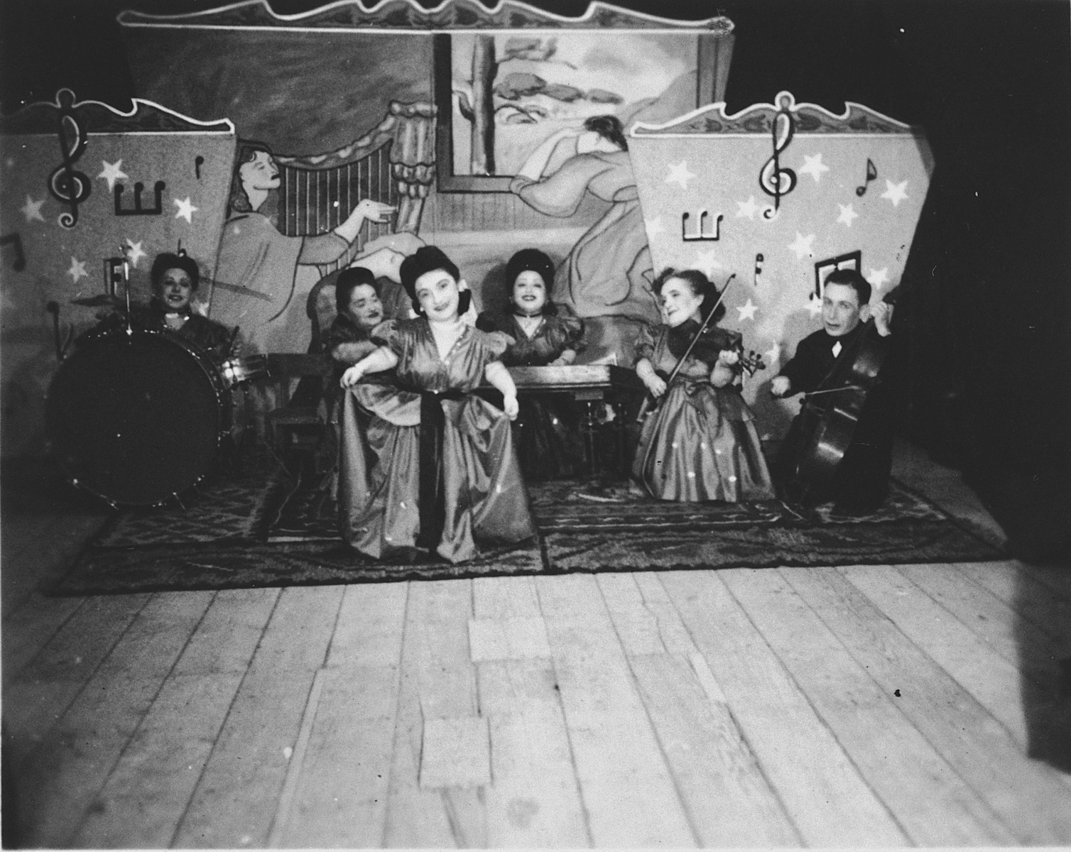 Members of the Ovici family, a family of Jewish dwarf entertainers known as the Lilliput Troupe, who survived Auschwitz, perform on stage.