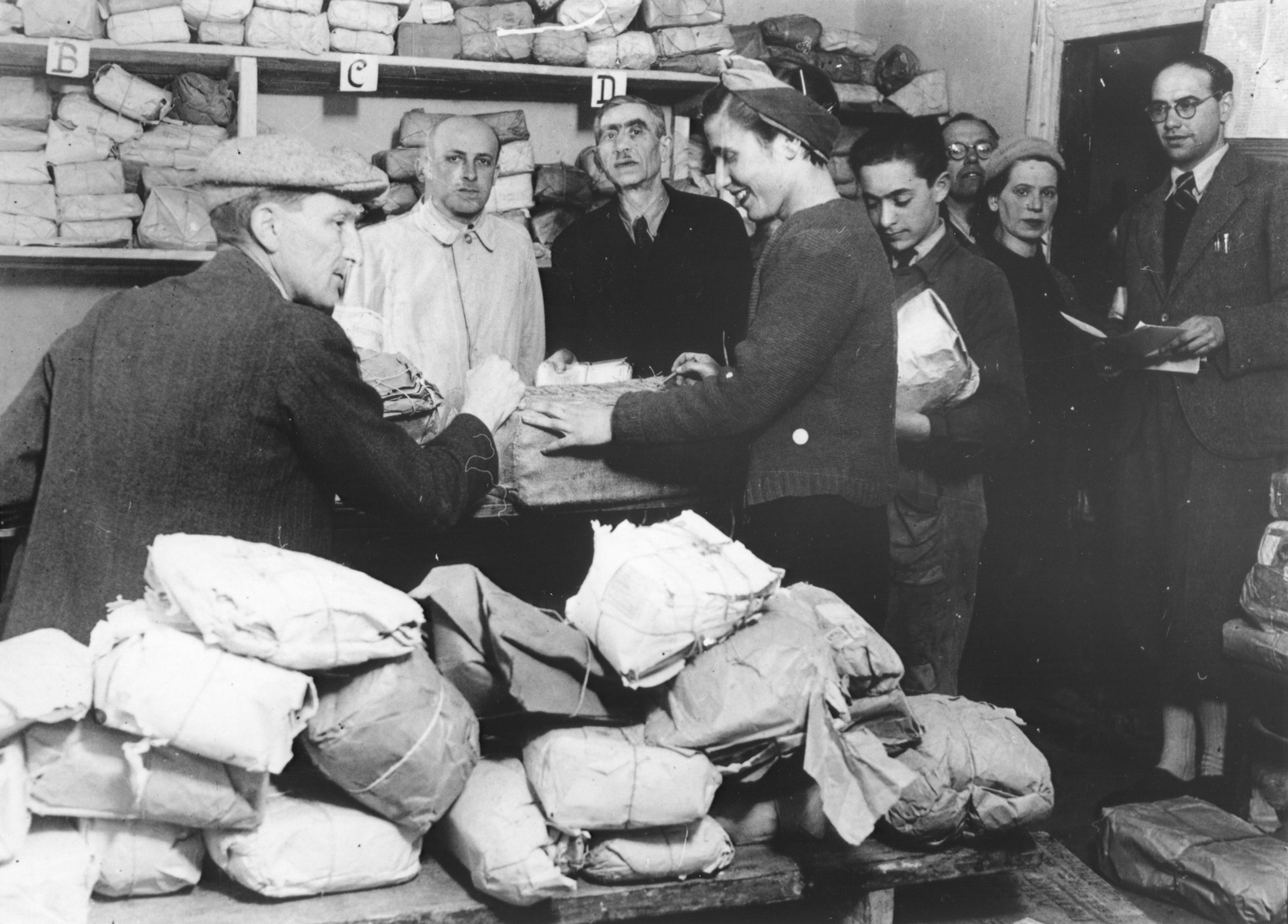 Jews line up to receive packages at the post office in the Opole Lubelskie ghetto.