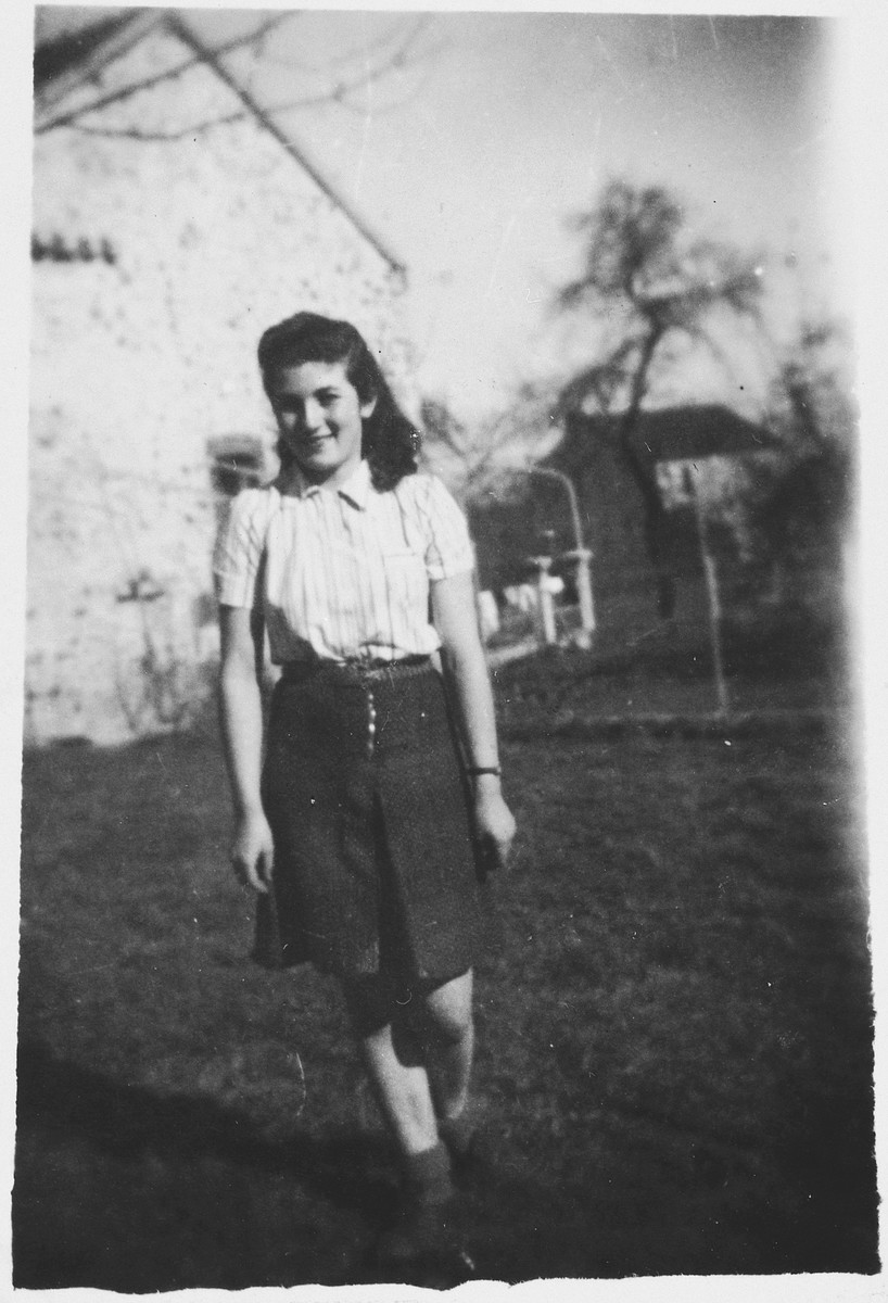 Portrait of a young Jewish refugee woman, Louise Budnik, on the grounds of the Chateau de Chabannes OSE [Oeuvre de Secours aux Enfants] children's home.