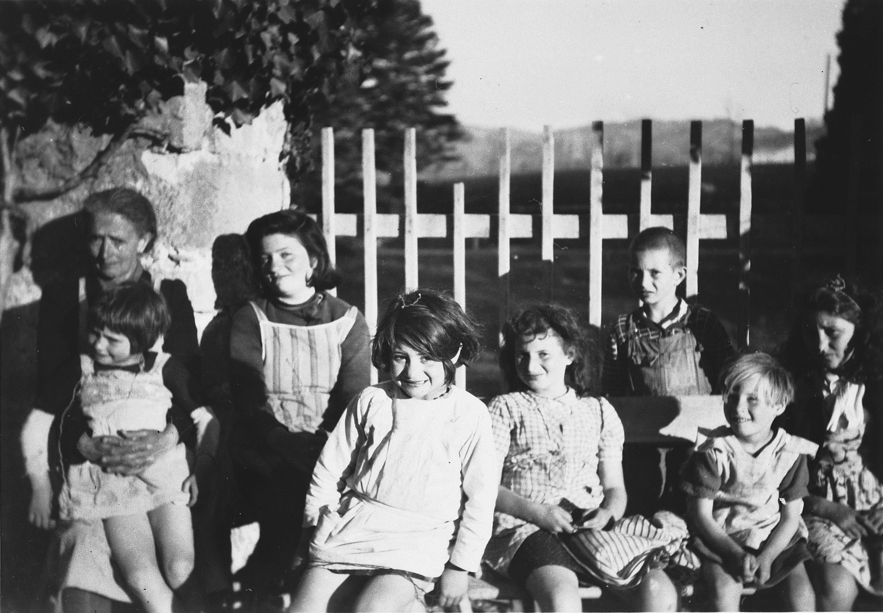 Madam Nadal  poses with a group of younger children in Chateau de la Hille.  Josette Mendes (now Zylberstein) is pictured in the center, front.
