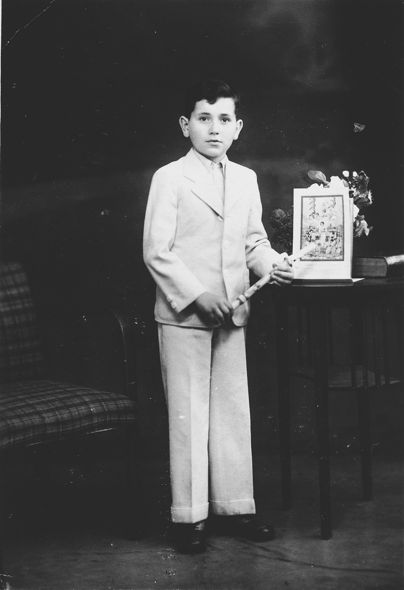 Studio portrait of a Jewish boy holding a Torah pointer [probably at his Bar Mitzvah].  Pictured is Rudolf Bruck, the son of Victor and Mimi Bruck.