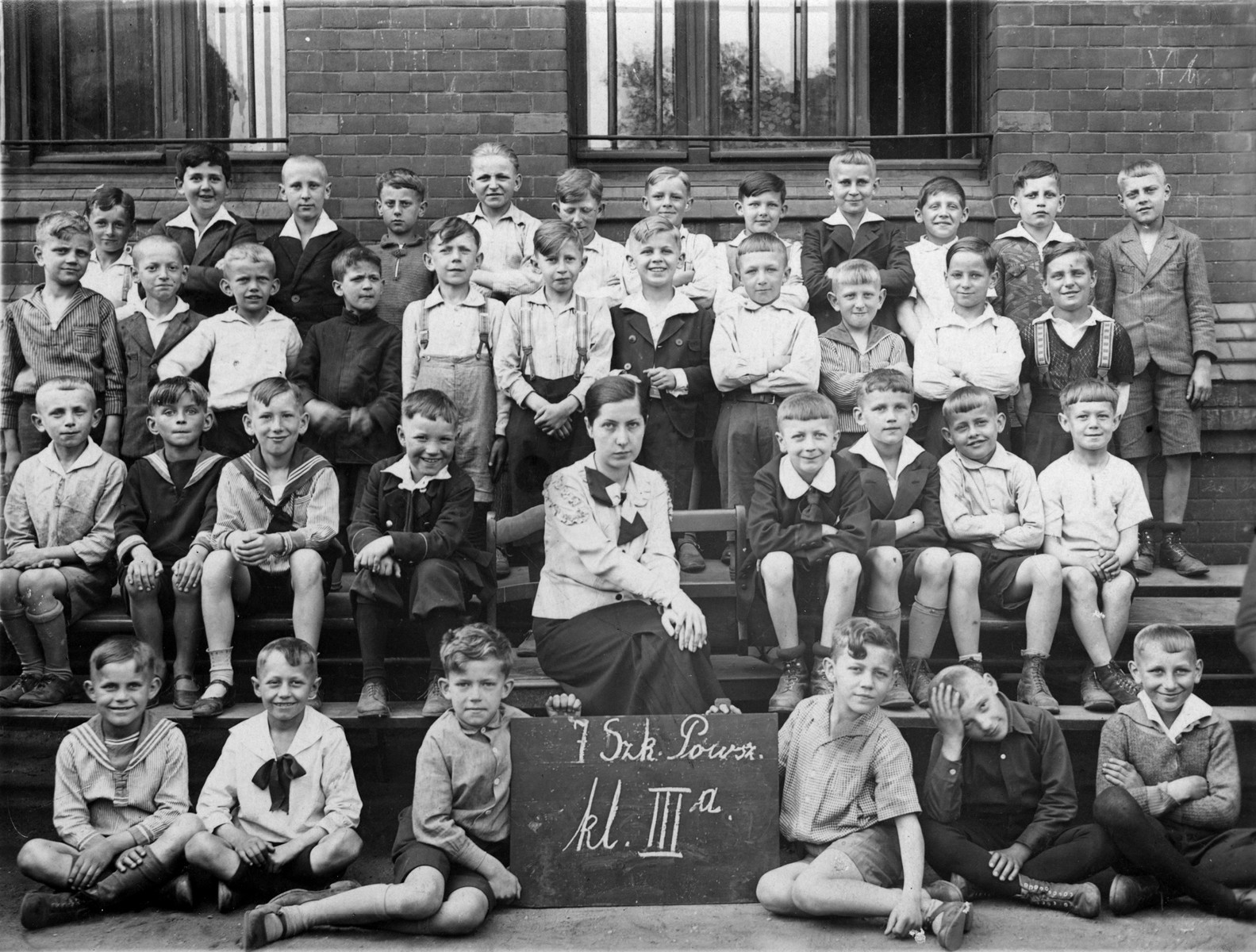 Group portrait of students in the third class of a Polish elementary school in Poznan.  Among those pictured is a Jewish child, Zygmunt Bauman (top row, left) who is the donor's father.