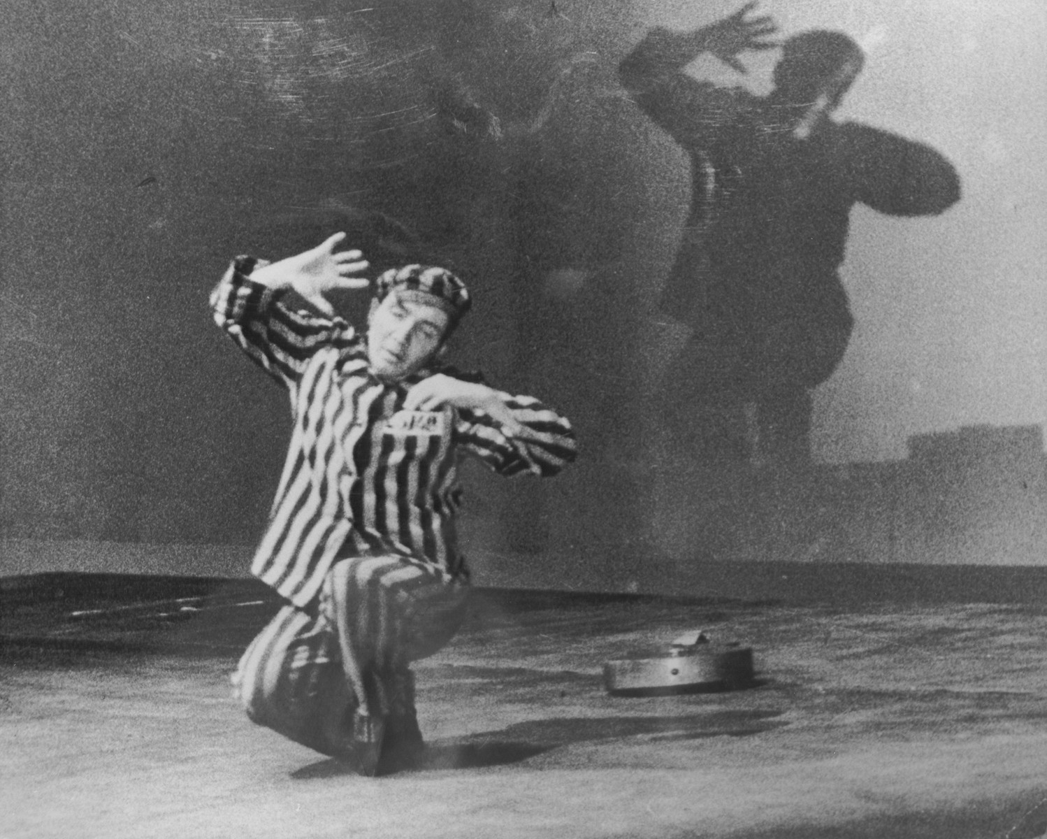 "Aleksander Kulisiewicz, dressed in a concentration camp uniform, performs ""Muselman"" at the Theater Communale in Bologna, Italy."