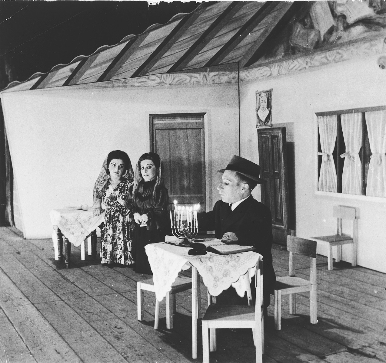 Members of the Ovici family, a family of Jewish dwarf entertainers who survived Auschwitz, perform a Hanukkah skit on stage.  Pictured from left to right are Perla, Elizabeth and Micki Ovici.