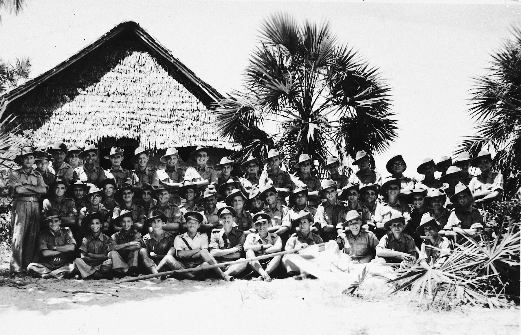 Group portrait of 52 former Jewish internees of Mauritius in an army unit in Mombasa, Kenya.  They would later officially become part of the Jewish Brigade.  Among those pictured are Hersh Makowski, Werner Szerevski, Heinrich Wellisch, Eric Gross and Israel Makowski.