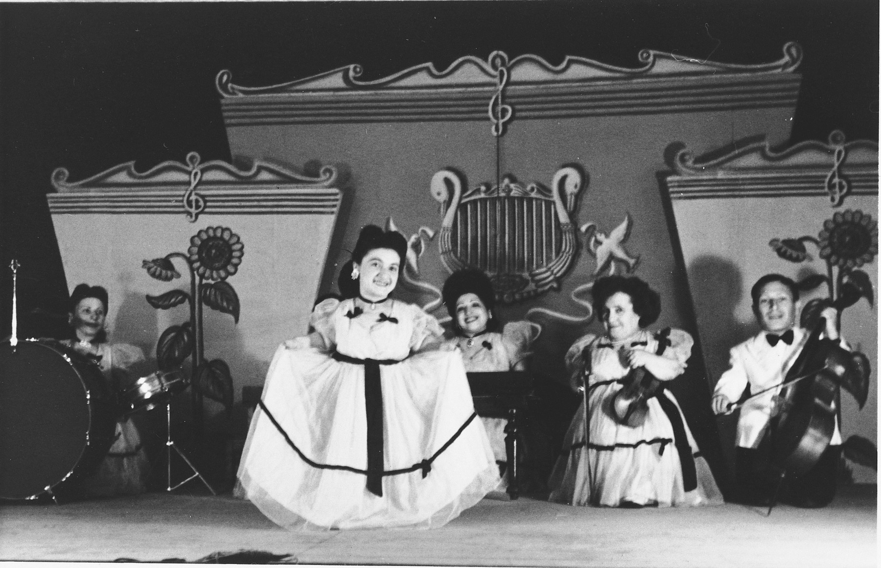 Members of the Ovici family, a family of Jewish dwarf entertainers known as the Lilliput Troupe, who survived Auschwitz, perform on stage in Israel.