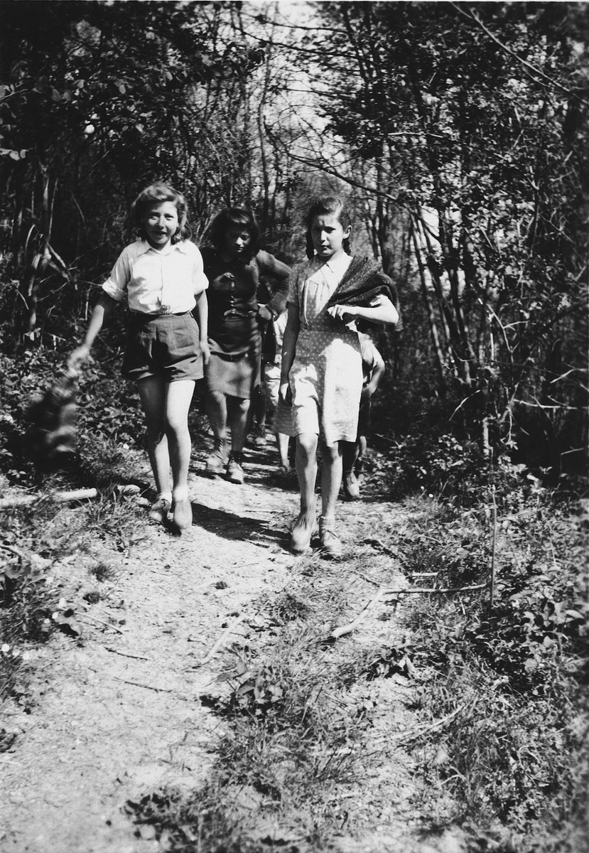 Three girls go for a walk through the woods near Chateau de la Hille.  Edith Jankeliewicz (now Esther Hocherman) is on the left.  Martha Storosum is in the center.