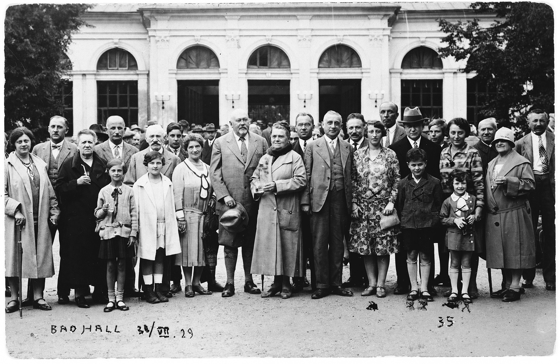 Visitors pose with glasses of mineral water in front of a hotel at the Bad Hall resort.  Among those pictured are the Fuchs family.