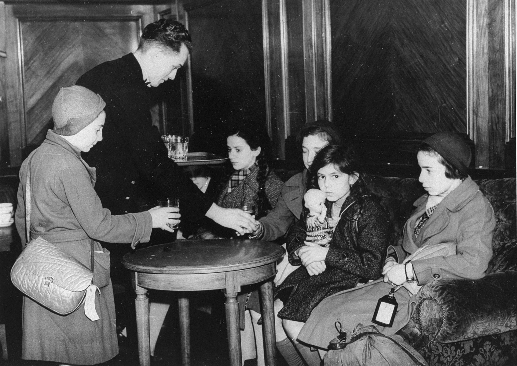Jewish refugee children, who are members of the first Kindertransport from Germany, arrive in Harwich, England.