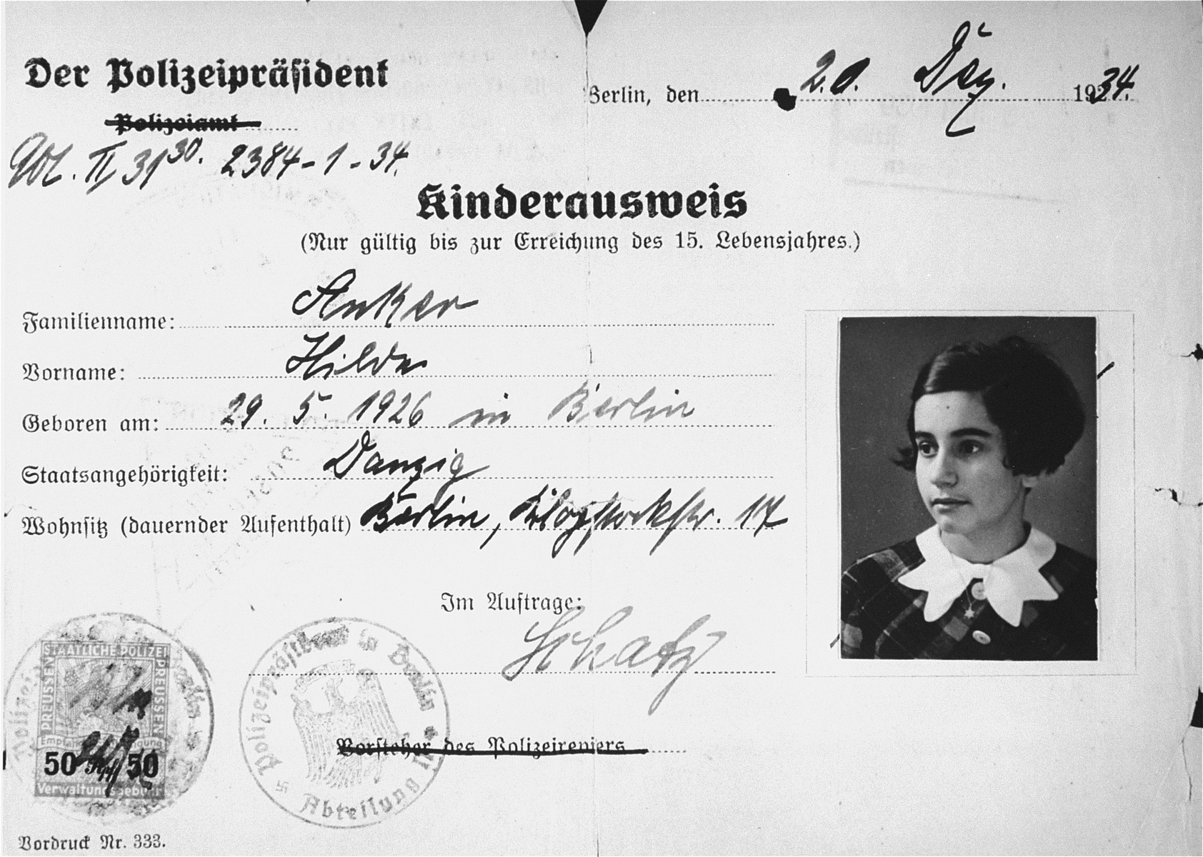 Children's identification card issued to eight-year-old Hilde Anker in December 1934, that was used in lieu of a passport when she travelled to England on a Kindertransport in 1939.  The back side of the document is stamped June 13, 1939.