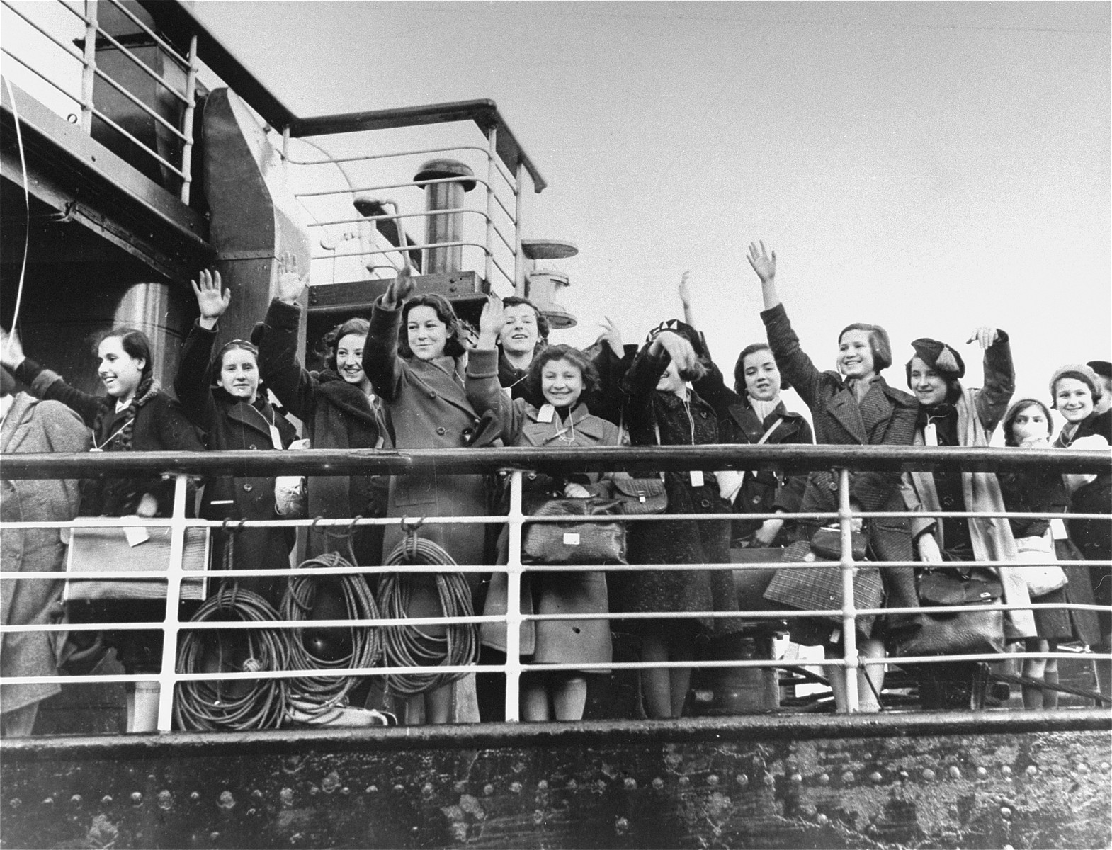 Jewish refugee children, who are members of the first Kindertransport from Germany, arrive in Harwich, England.  Among those pictured is Vera Ribertsky, sixtth from the left.