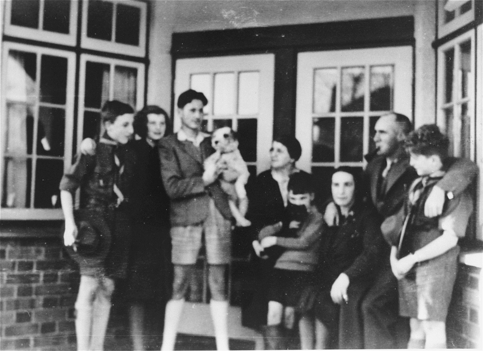 Three Jewish refugee children from Vienna who came to England on a Kindertransport, pose with their foster family, Mary and Ashford Moar, in Bristol, England.    Pictured at the left are Steven and Eva Kollisch; at the far right is their brother, Peter; their foster parents, Ashford and Mary Moar, stand next to Peter.
