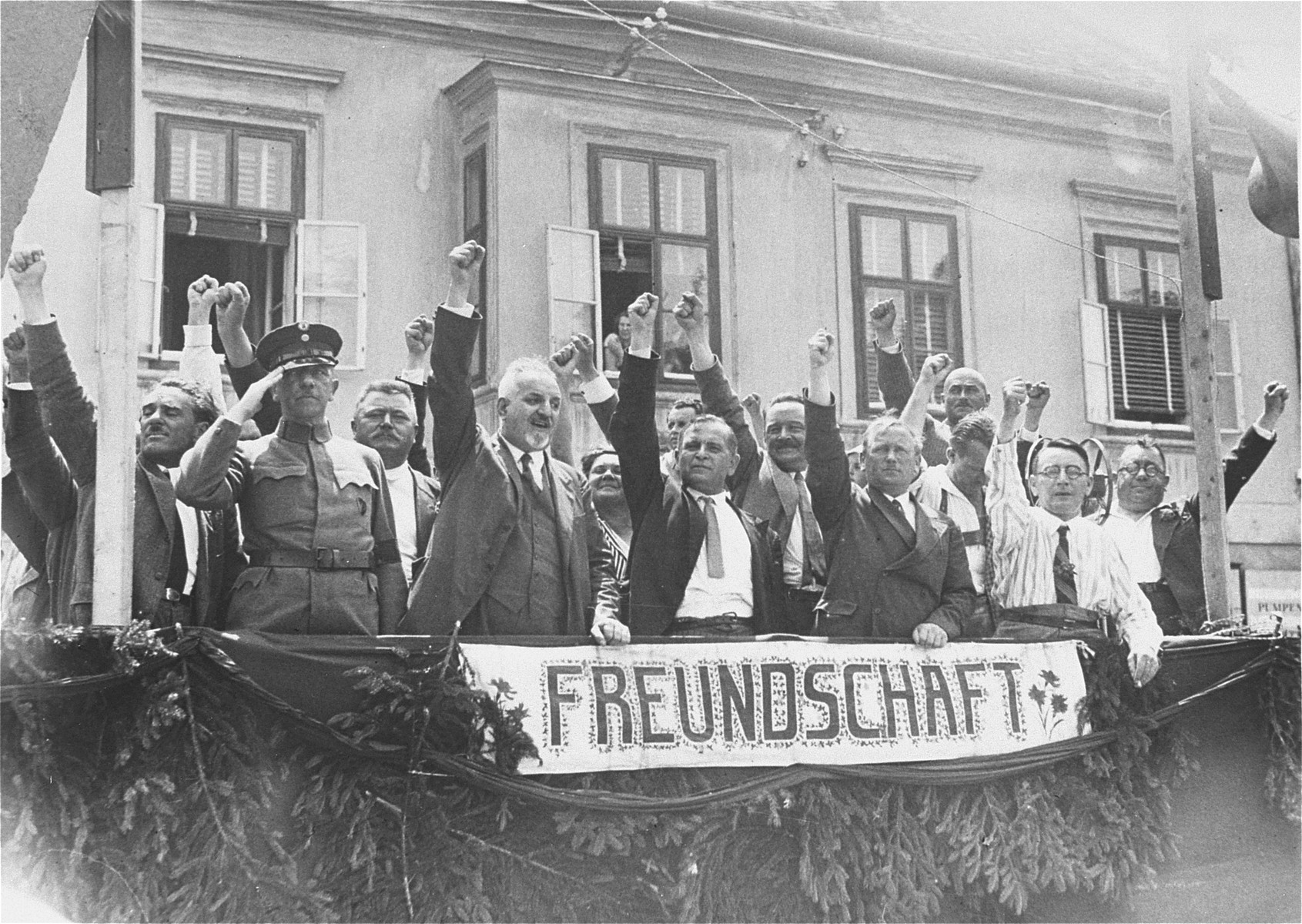 "The leader of Austria's Social Democrats salutes the Republican ""Schutzbund"" during its demonstration against the Nazi storming of the Social-Democratic party house the previous week.   Pictured from left to right, are Major Eifler, Military Commander of the Republican ""Schutzbund""; Speiser, Town Councillor; Otto Bauer, National Deputy; Dr. Deutsch, leader of the Social Democratic Party; and Till, Commander of the ""Schutzbund""."