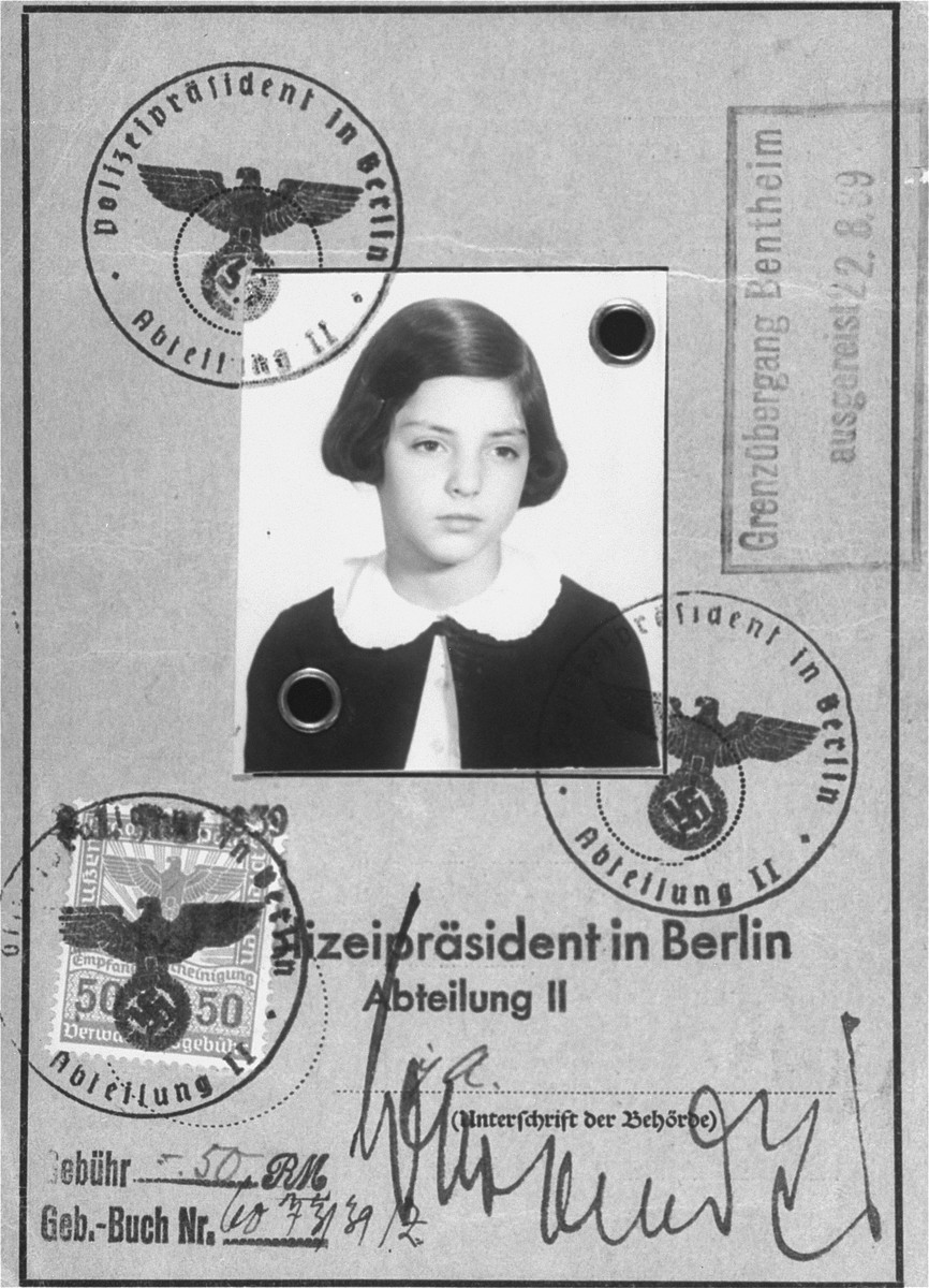 A passport issued to eleven-year-old Gertrud Levy (the donor), a German-Jewish refugee child, before her departure from Germany on a Kindertransport to England. The passport bears the stamp of an immigration office in the United Kingdom.