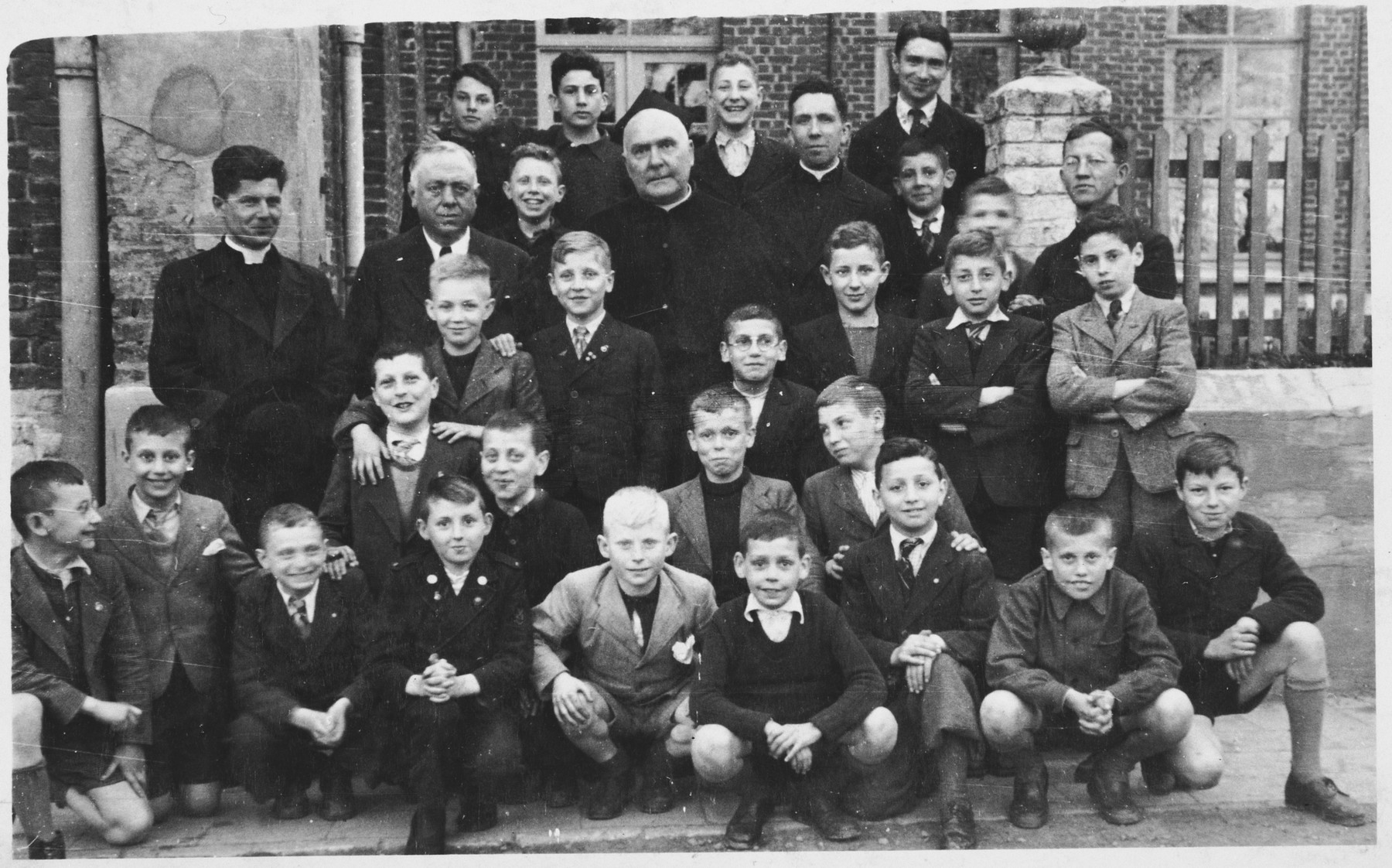 Group portrait of students at the Melle monastery, where Jewish boys were hiding during the German occupation of Belgium.  Among those pictured is Jacques Kucinski (third row, second from the right).