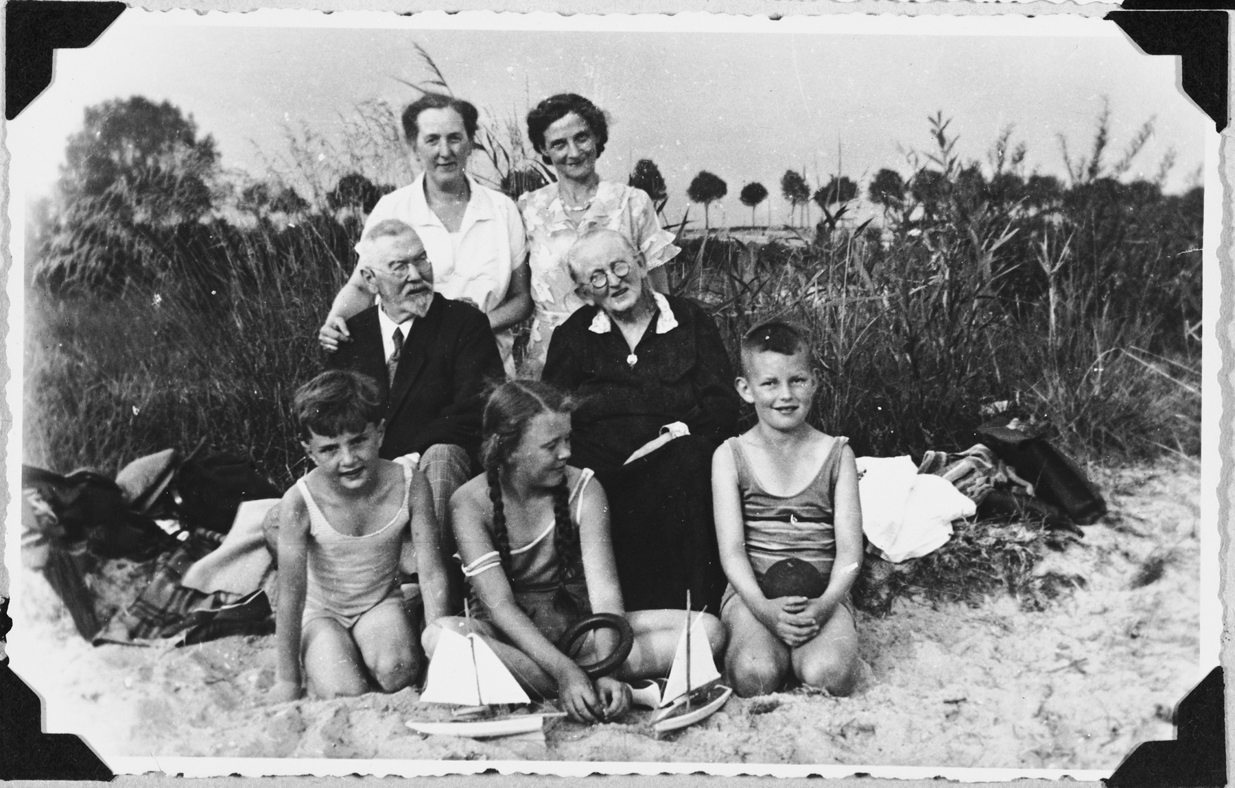 Fritz Glueckstein (bottom, left) poses on the beach with his Christian grandparents, aunt and cousins.