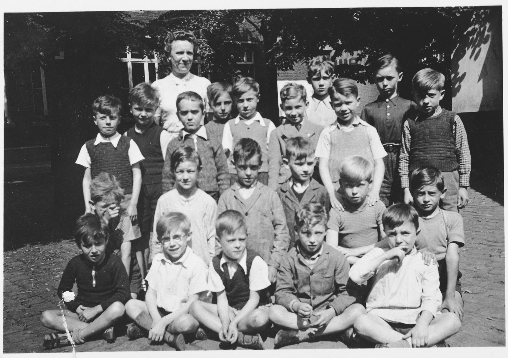 Group portrait of students at an elementary school in Brussels attended by both Jewish and non-Jewish children.