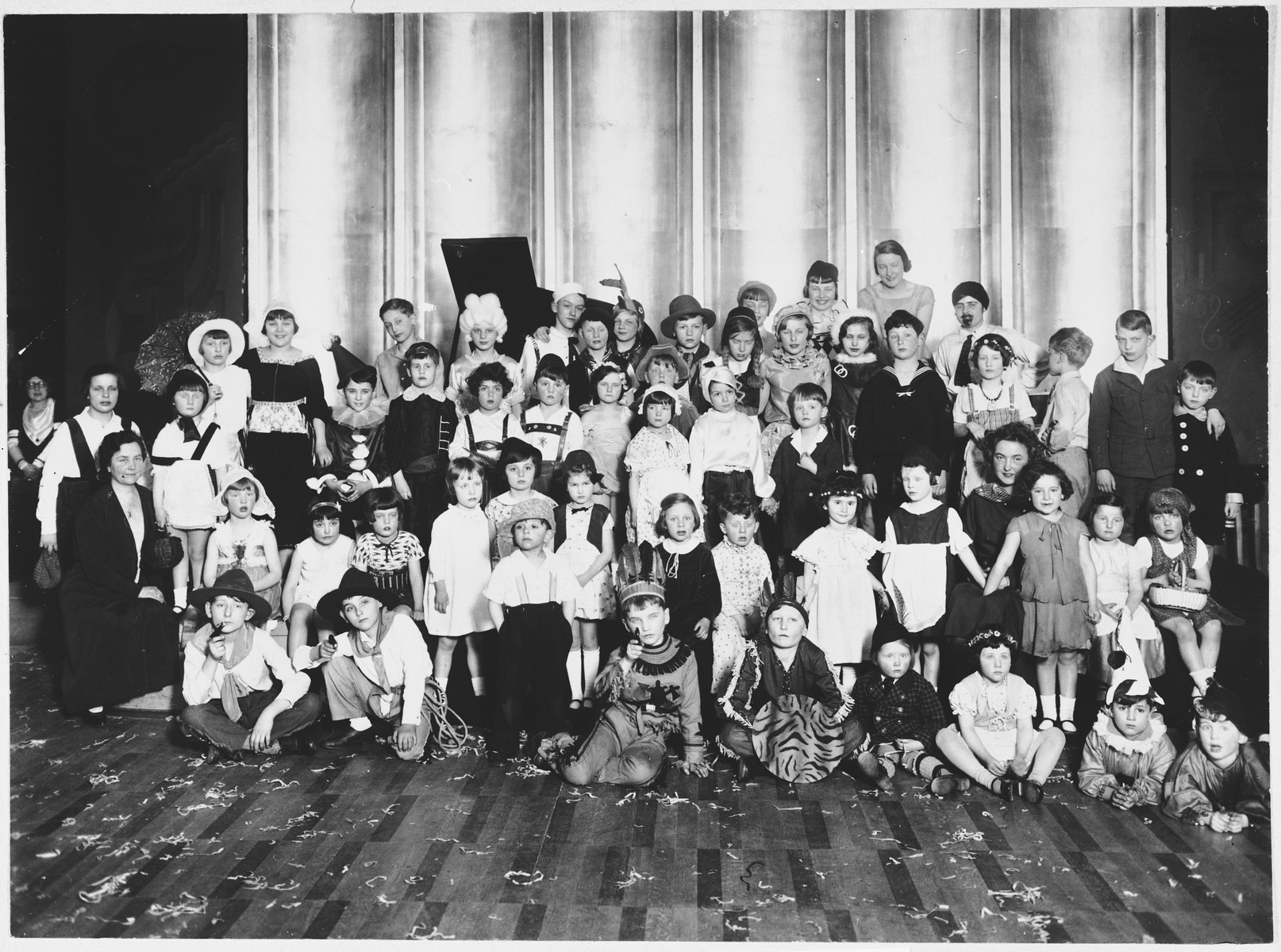 Class portrait of Jewish school children dressed in Purim costumes.  Among those pictured is Fritz Glueckstein.