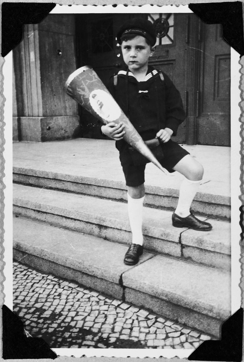 Fritz Glueckstein holds a cone of treats on his first day of school.